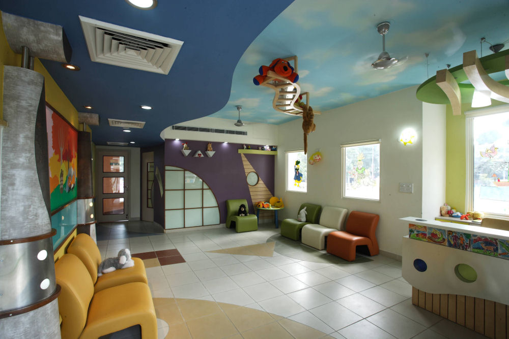 Adharshila vatika children center colorful building for Interior designs play