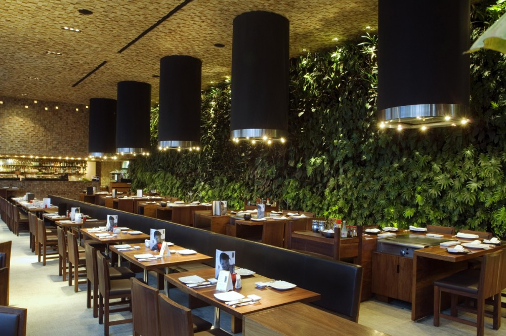 Japonez glass restaurant with natural green wall