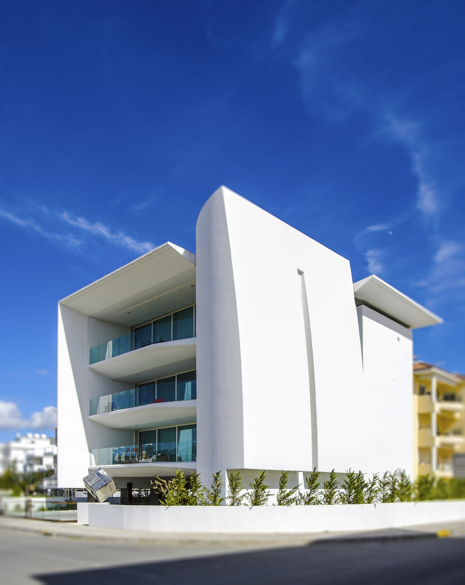 Proton by constantinos kalisperas architectural studio for Commercial building elevation photos